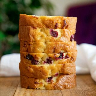 Cranberry Bread stacked on wooden table