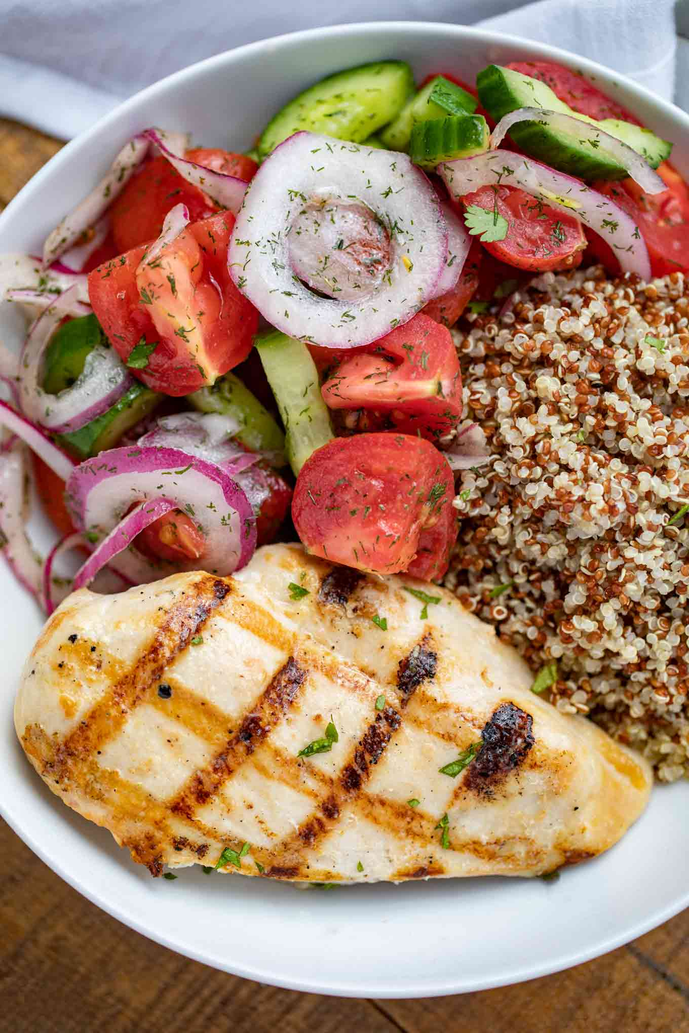 Grilled Chicken with Cucumber Tomato Salad and Quinoa in bowl