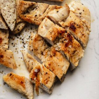 Grilled Chicken sliced on cutting board