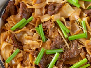 Cantonese Beef Chow Fun Recipe in pan with Green Onions