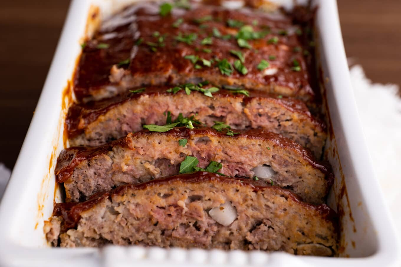 Classic Beef Meatloaf sliced in loaf pan