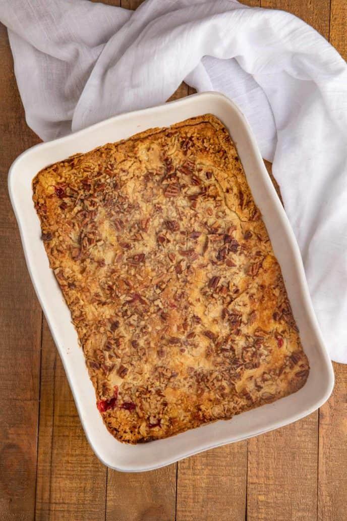 Cherry Dump Cake Recipe in Baking Dish with white towel