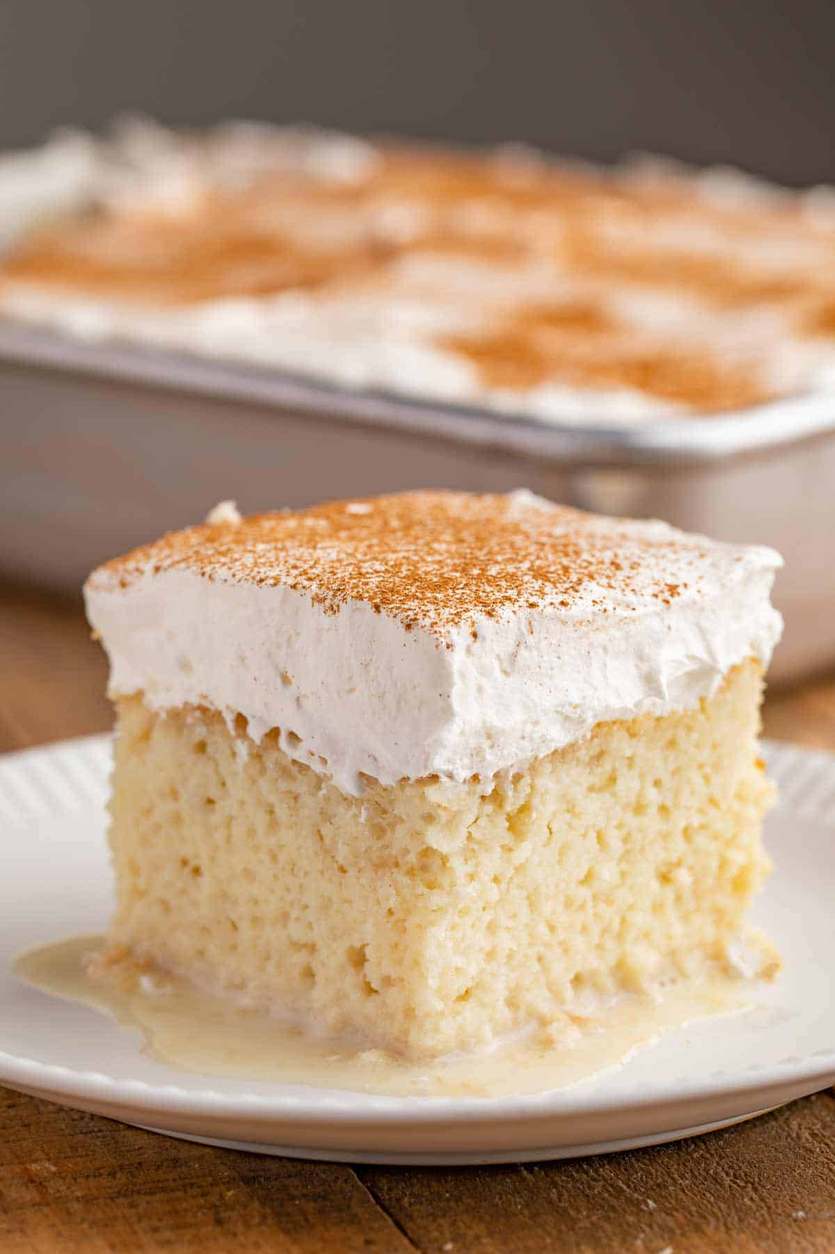 Slice of Tres Leches Cake on plate