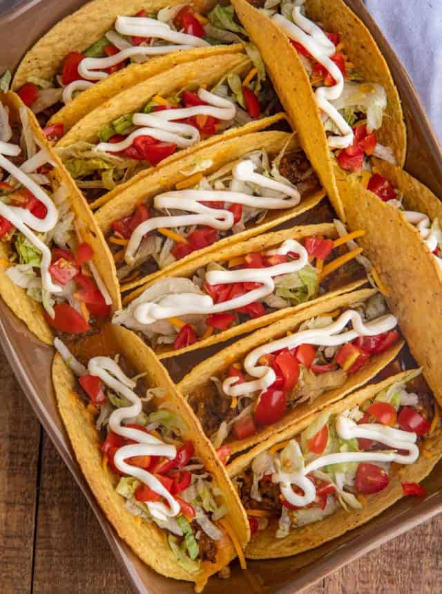 Baked Beef Tacos with toppings in baking dish