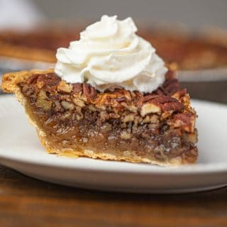 Pecan Pie with Whipped Cream on Plate