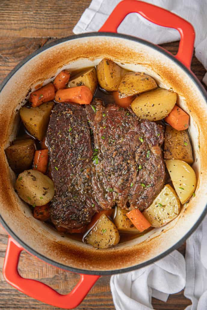 Classic Pot Roast with potatoes and carrots in dutch oven