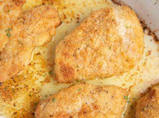 Crispy Butter Chicken in white baking dish