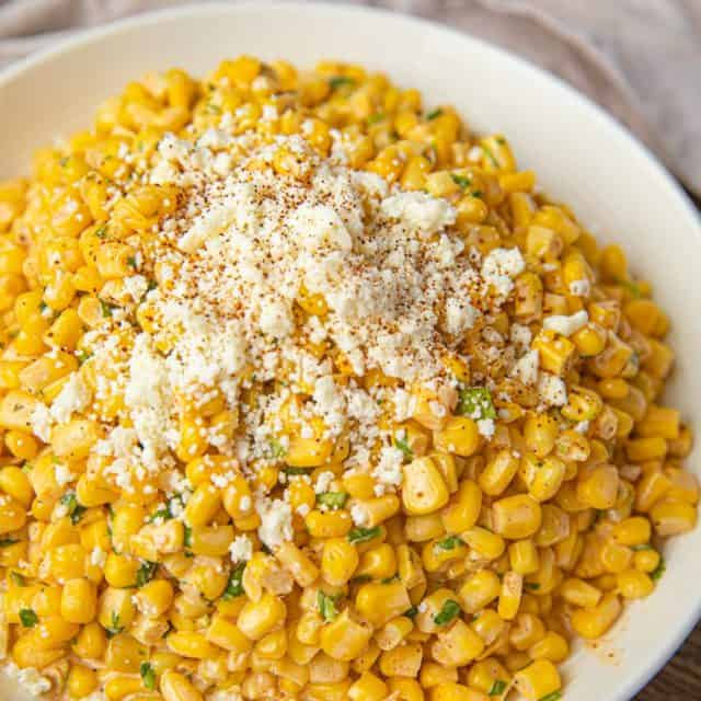 Mexican Corn Salad with Cotija Cheese sprinkled on top
