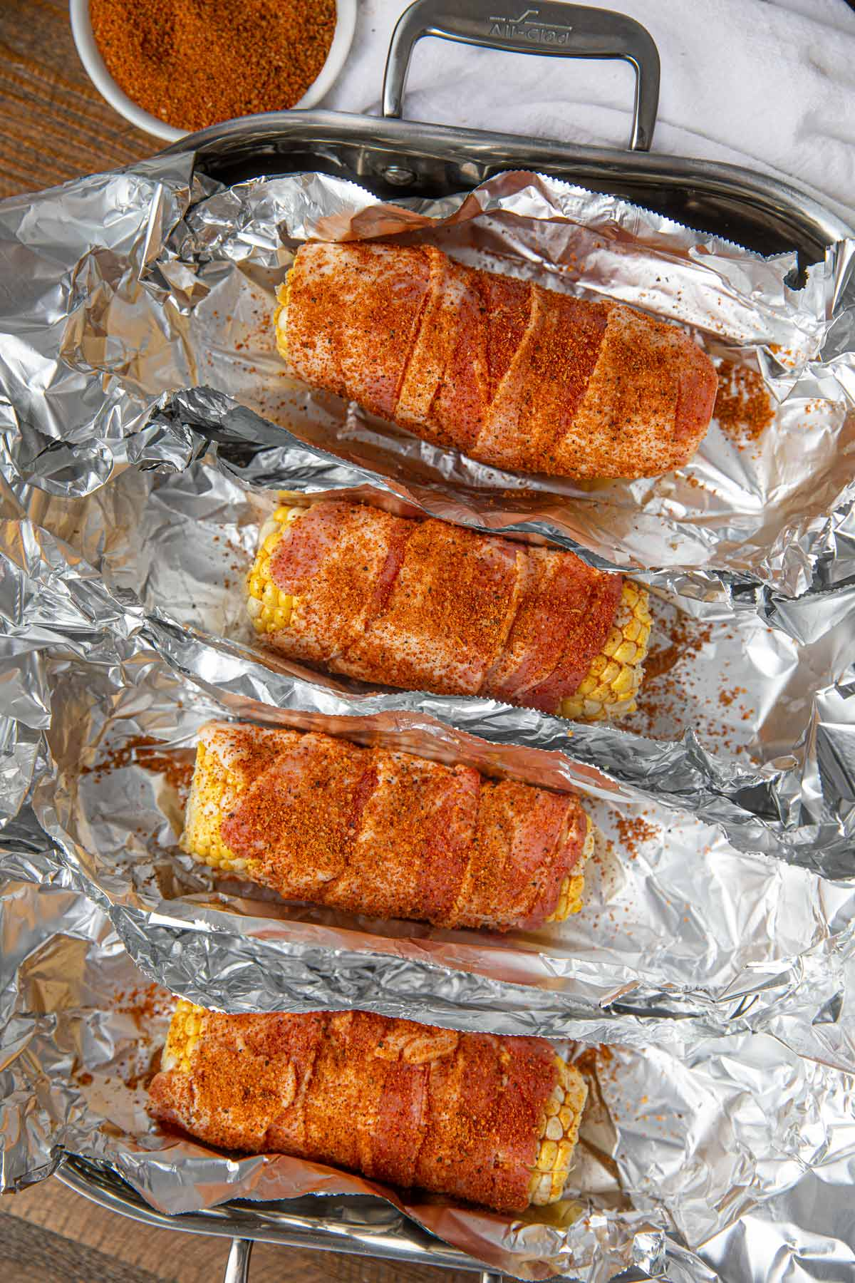 BBQ Oven Roasted Corn with Bacon in pan with foil
