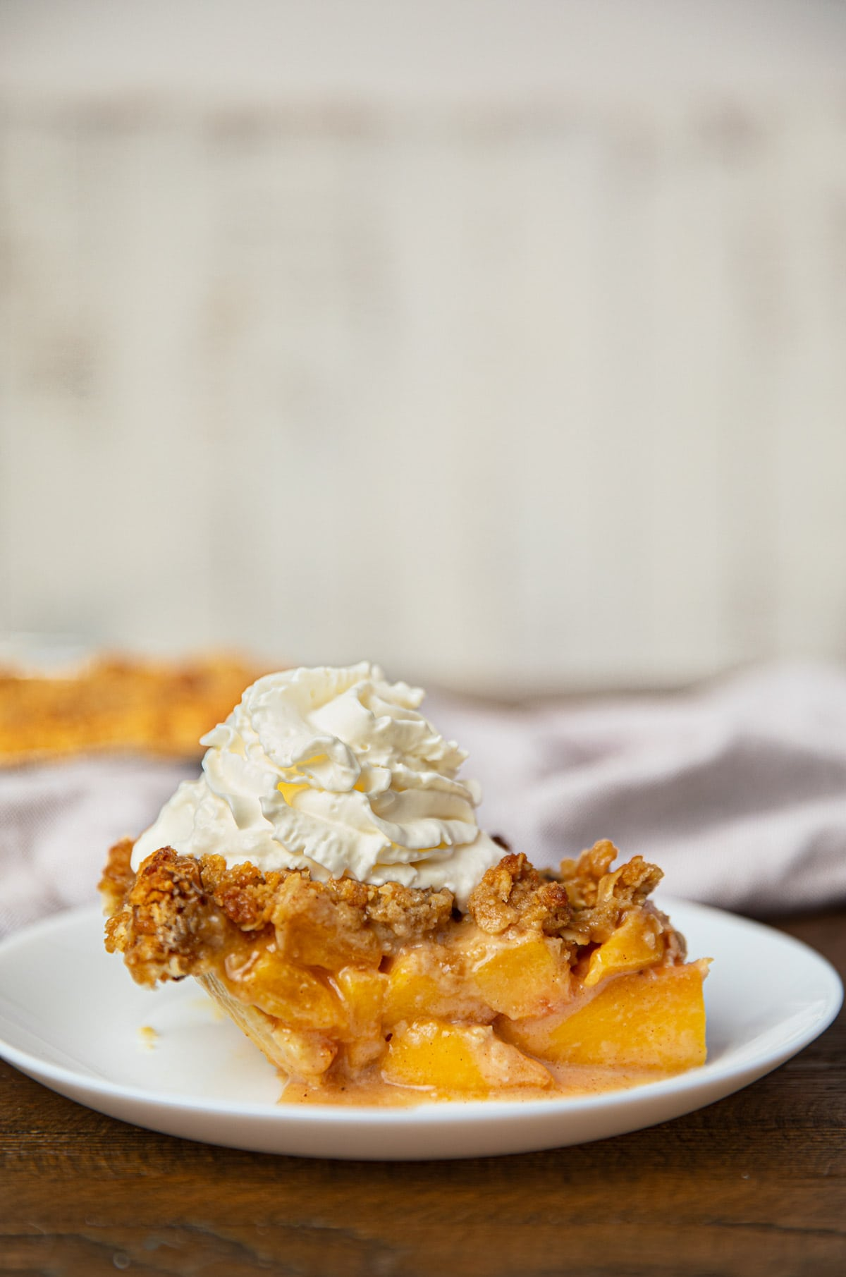 Slice of Peach Crumb Pie