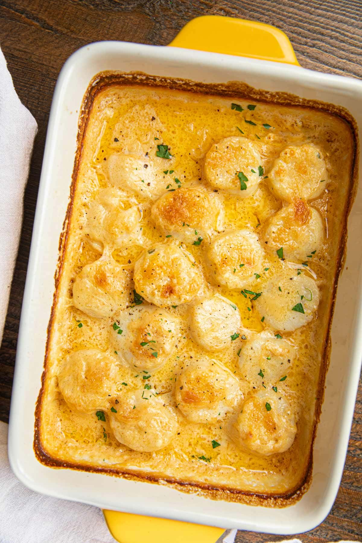 Scallop Gratin in white and yellow baking dish