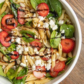 Spinach Pasta Salad with Strawberries in white bowl