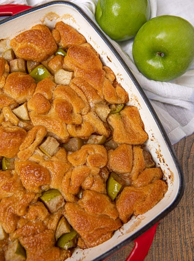 Apple fritter casserole in a red pan