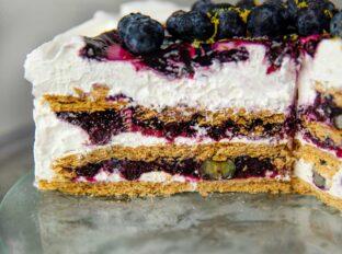 Blueberry Lemon Icebox Cake slice on cake dish