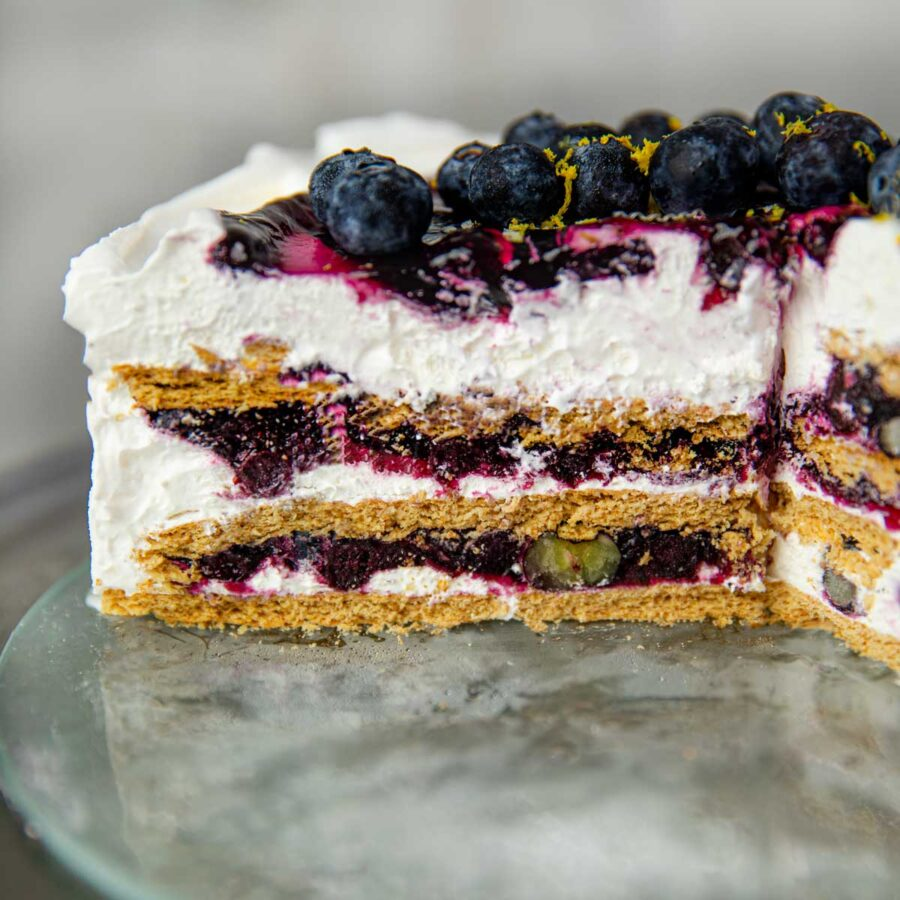 Blueberry Lemon Icebox Cake slice on cake dish