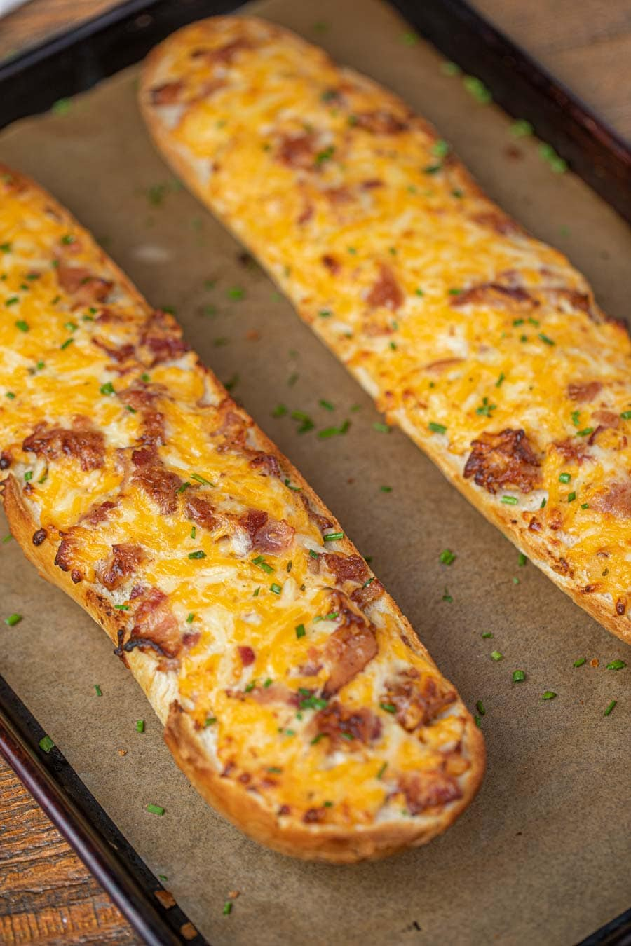 Sliced loaf of Cheesy Bacon Ranch Bread