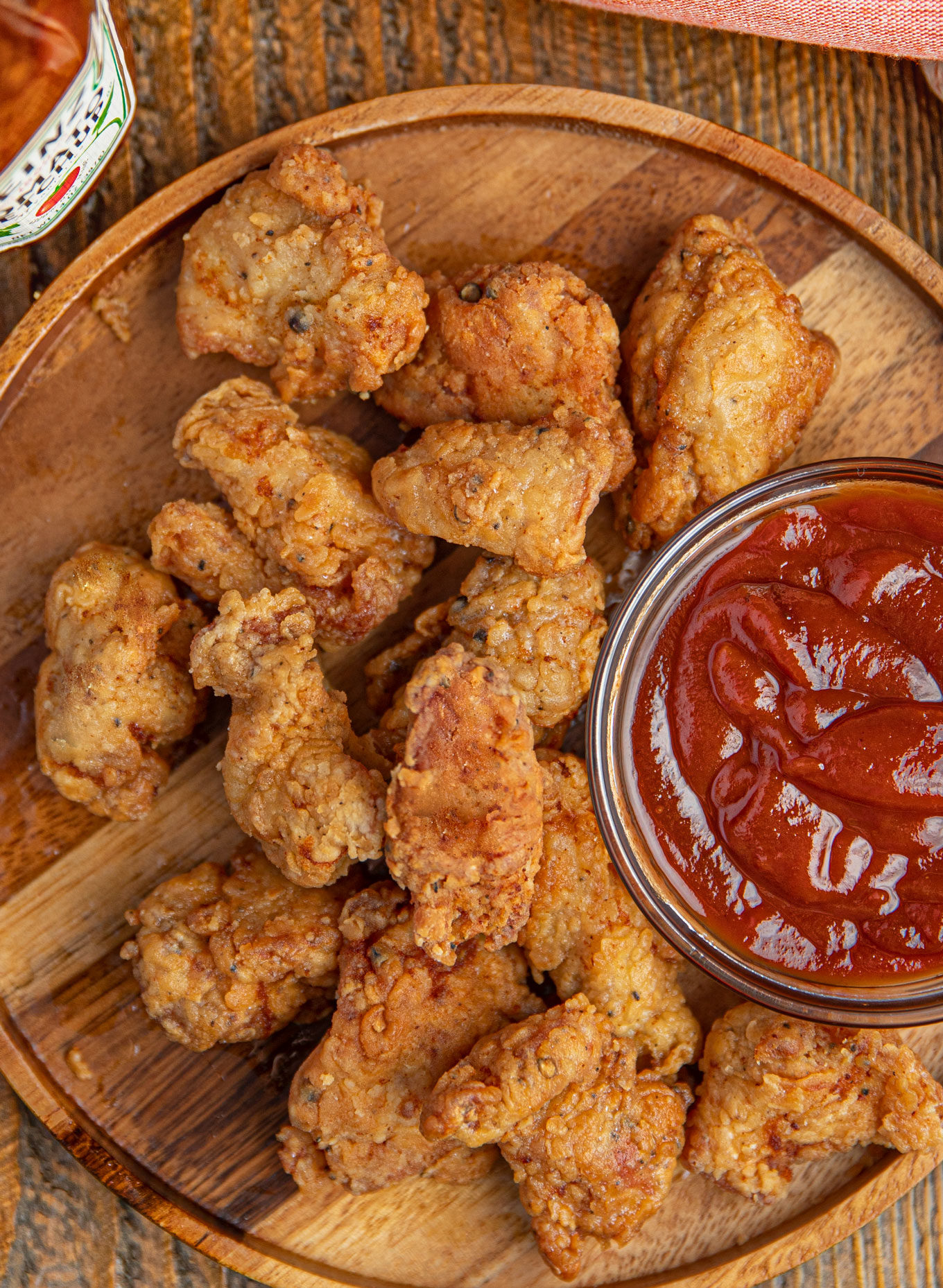Chicken nuggets on a plate with ketchup
