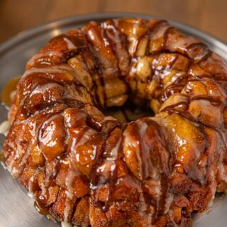Cinnamon Roll Monkey Bread on Silver Cake Stand