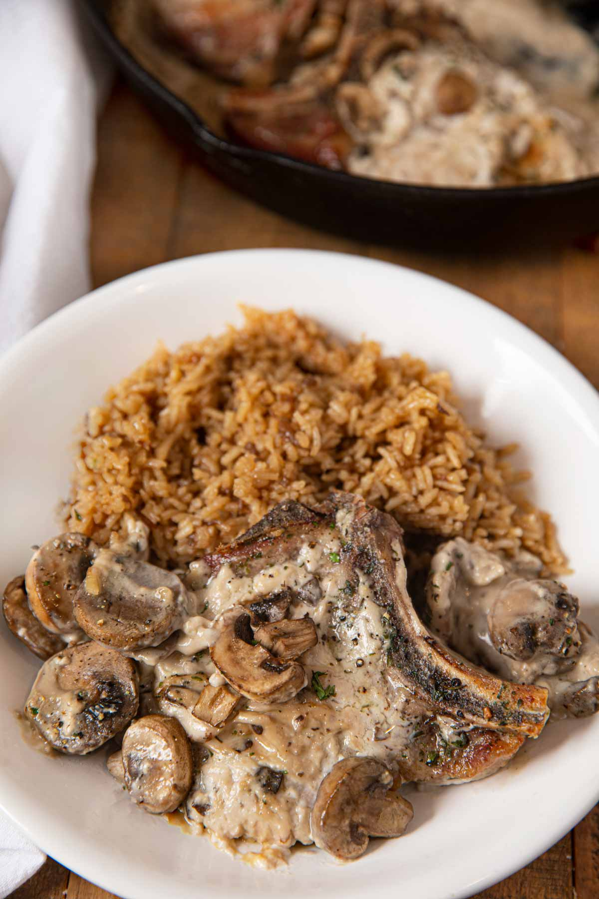 Mushroom Pork with Stick of Butter Rice in white Bowl