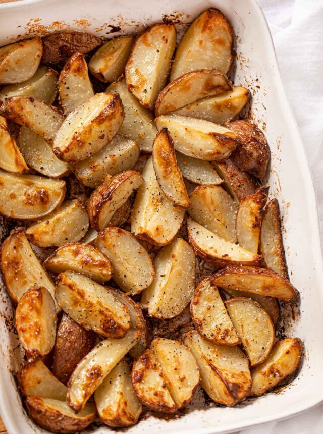 Roasted Red Potatoes in white baking dish