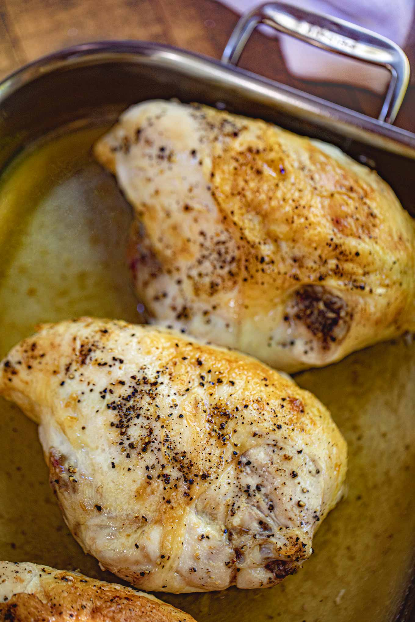 Baked Chicken Breasts with rib bones and skin