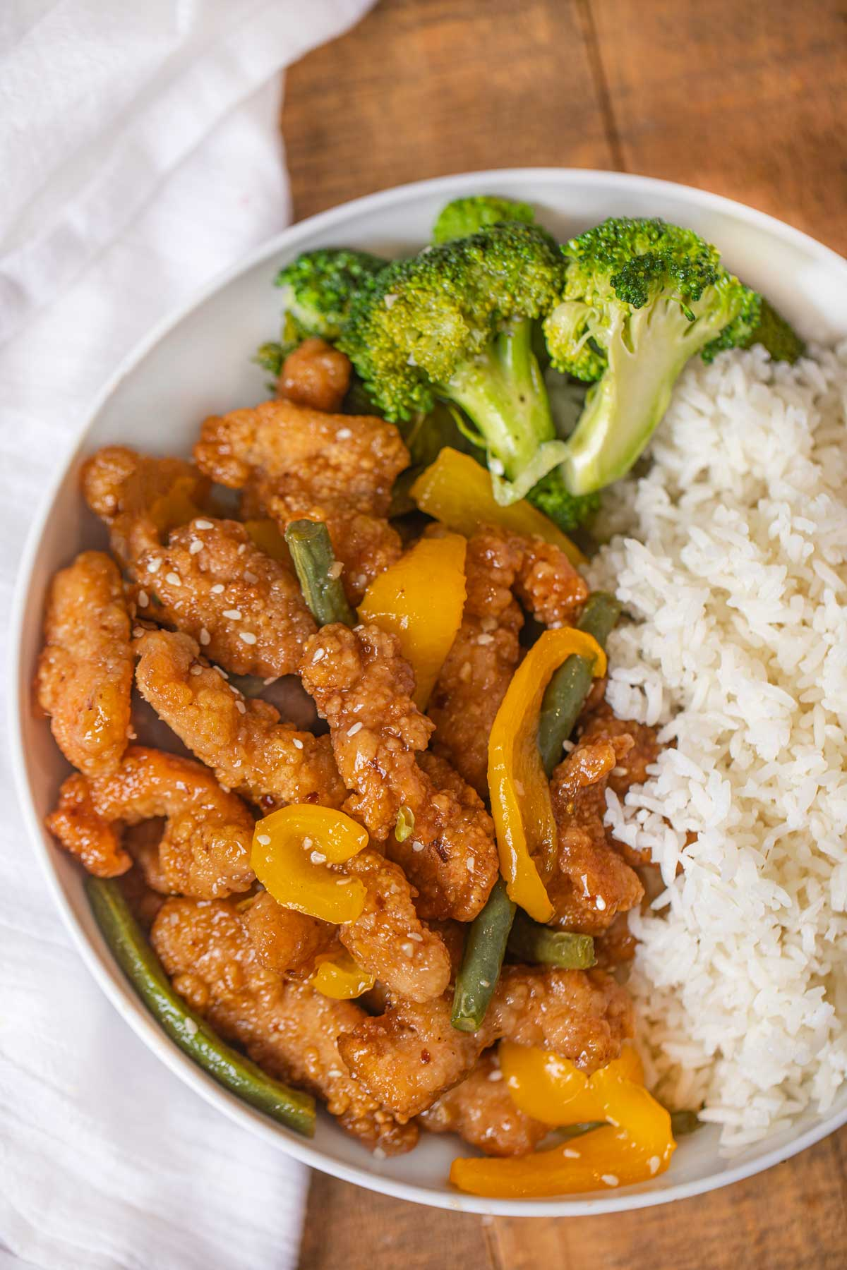 Honey Sesame Chicken Breast from Panda Express with steamed rice and broccoli in white bowl