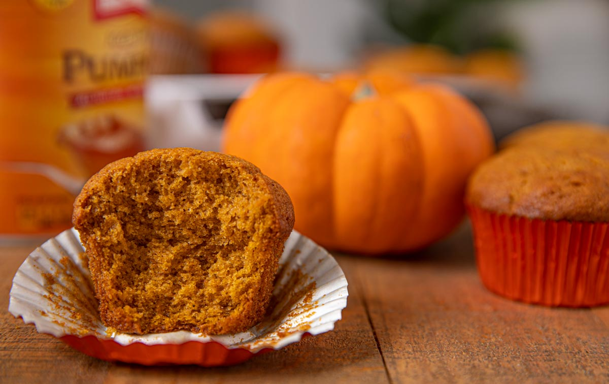 Moist Pumpkin Muffins on wooden board