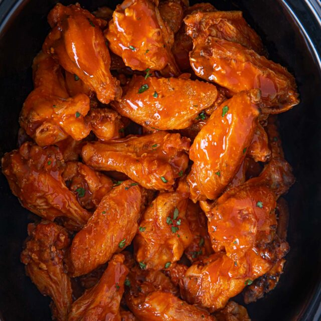 Slow Cooker Buffalo Wings in black pot