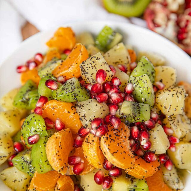 Winter Fruit Salad with Honey Poppy Dressing in White Bowl