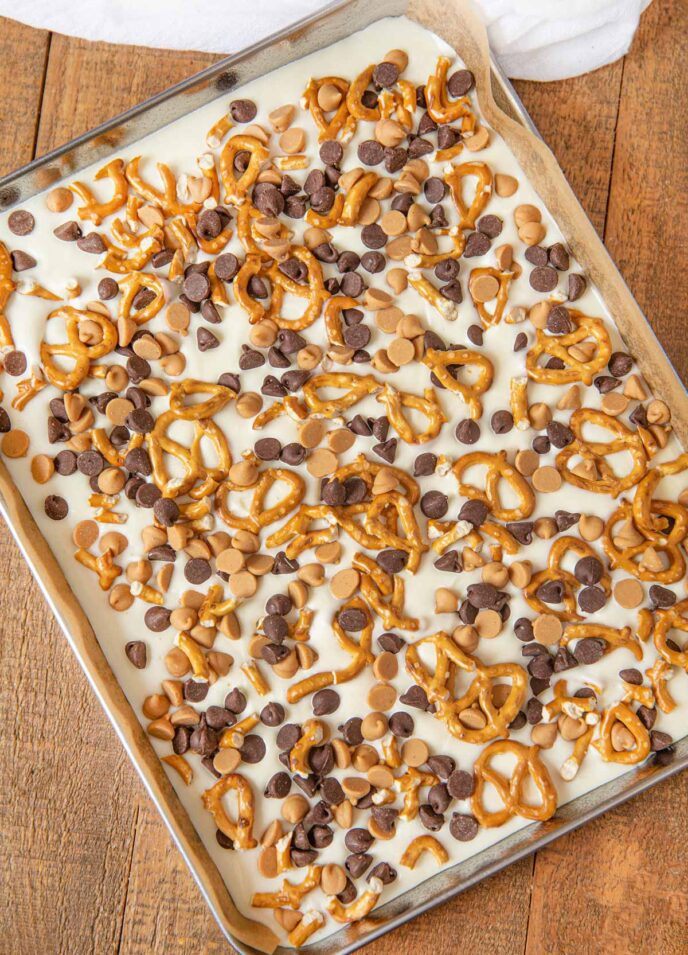 Sheet Tray with Chubby Hubby Bark whole with white chocolate, peanut butter chips, chocolate chips and pretzels