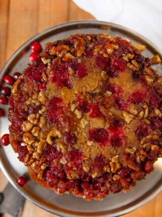 Cranberry Upside Down Cake on cake stand