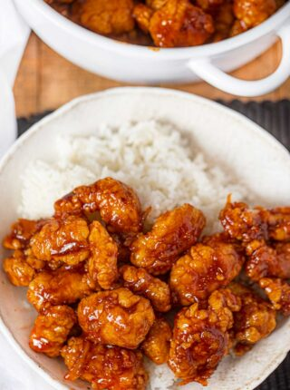 Orange Chicken with just 3 ingredients in bowl with white rice