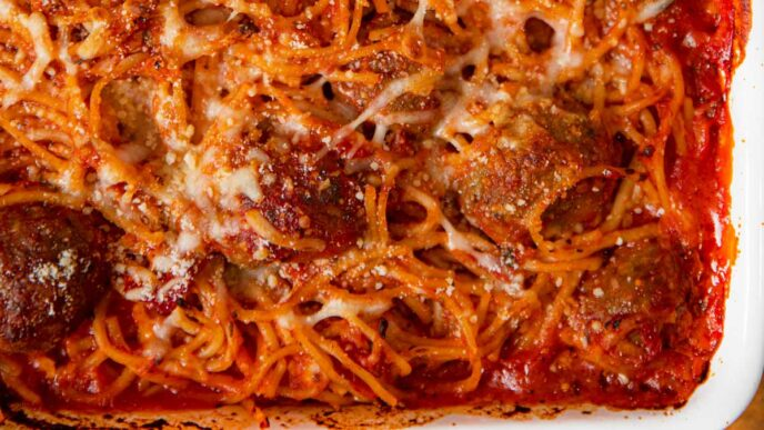 Baked Spaghetti and Meatballs in white baking dish