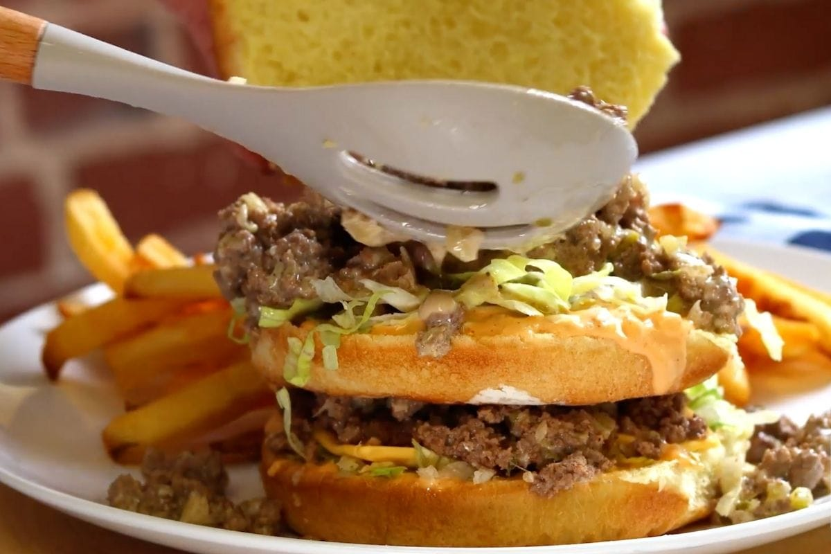 Big Mac Sloppy Joes being stacked on plate with fries