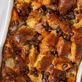 Chocolate Croissant Casserole Bake in white baking dish shot from top down