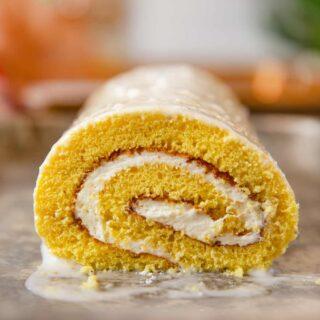 Lemon Cake Roll on baking sheet with glaze