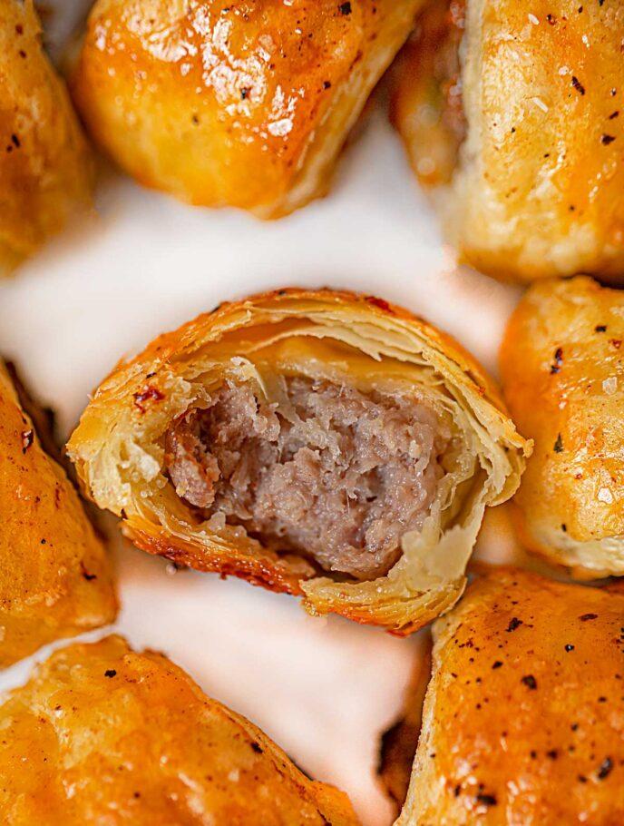 Bite taken from Sausage Rolls