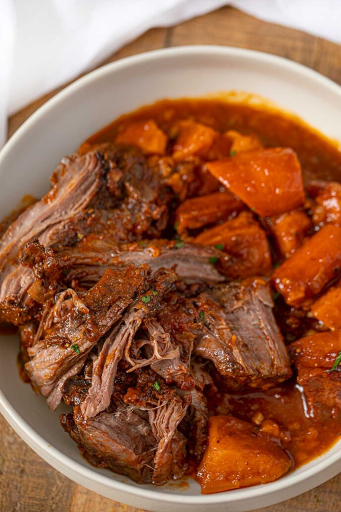 Crockpot Caribbean Pot Roast, Sweet Potatoes and Carrots in a bowl with gravy