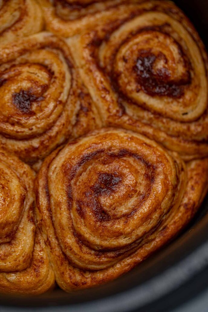 Crockpot cinnamon roll in crockpot without icing