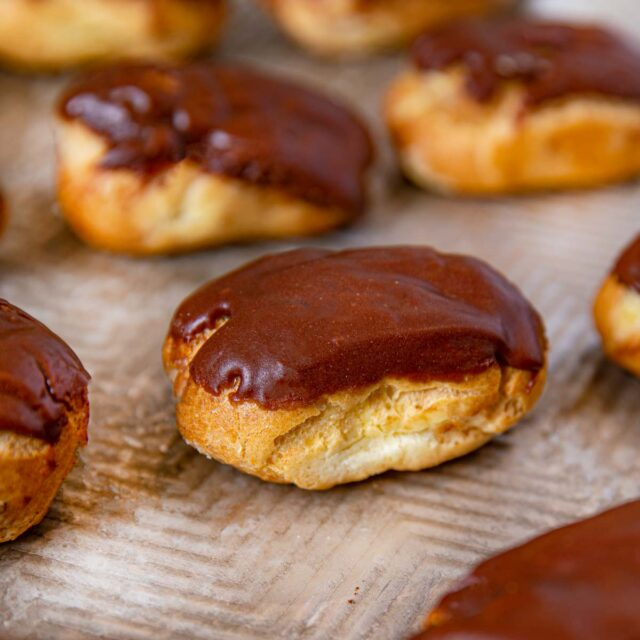 Chocolate Eclairs on baking sheet lined up