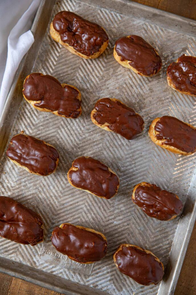 Chocolate Eclairs on baking tray