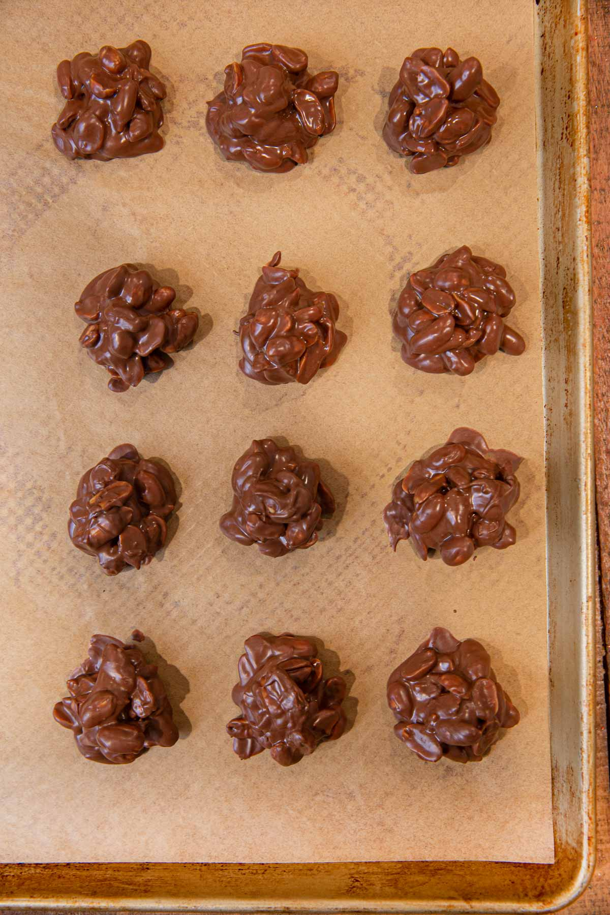 Chocolate Peanut Clusters on baking sheet