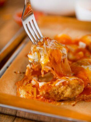 Domino's Hot Buffalo Chicken on fork