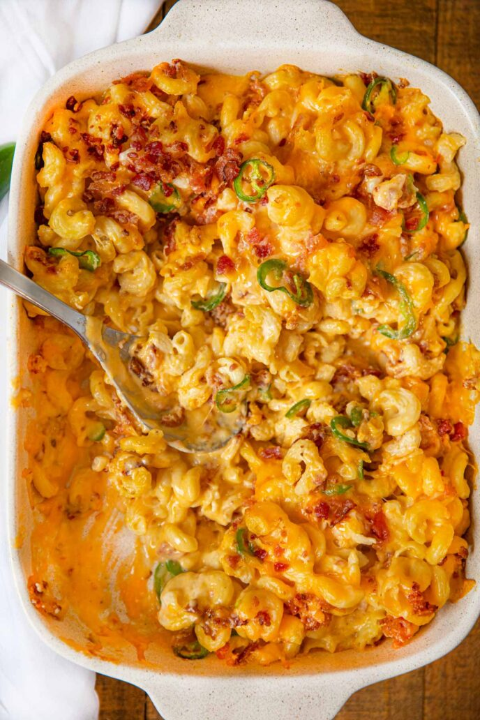 Jalapeno Popper Macaroni and Cheese in baking dish with scoop removed