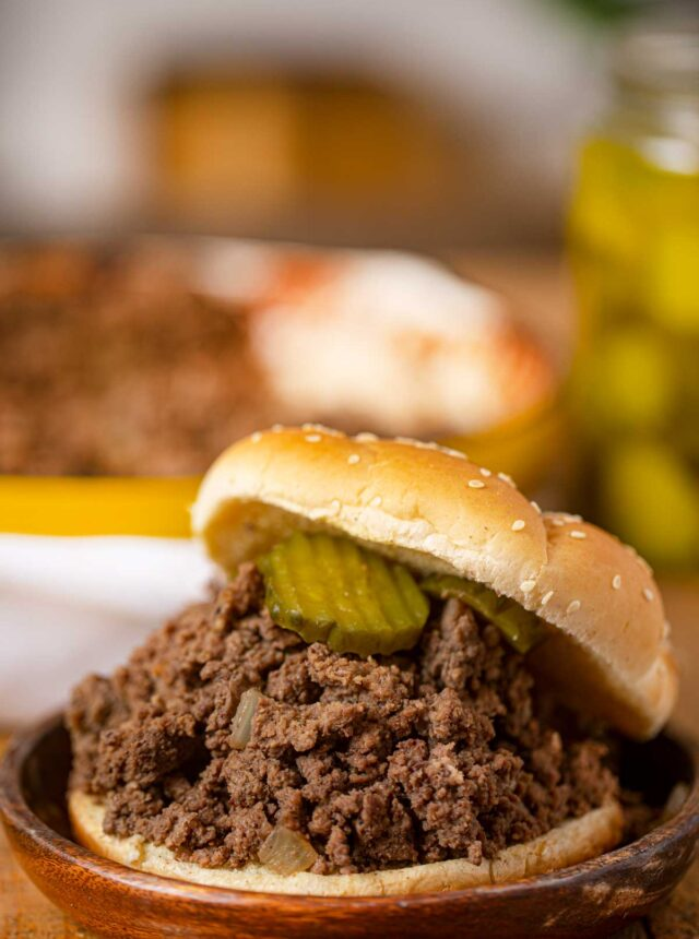 Loose Meat Sandwiches on hamburger bun with pickles