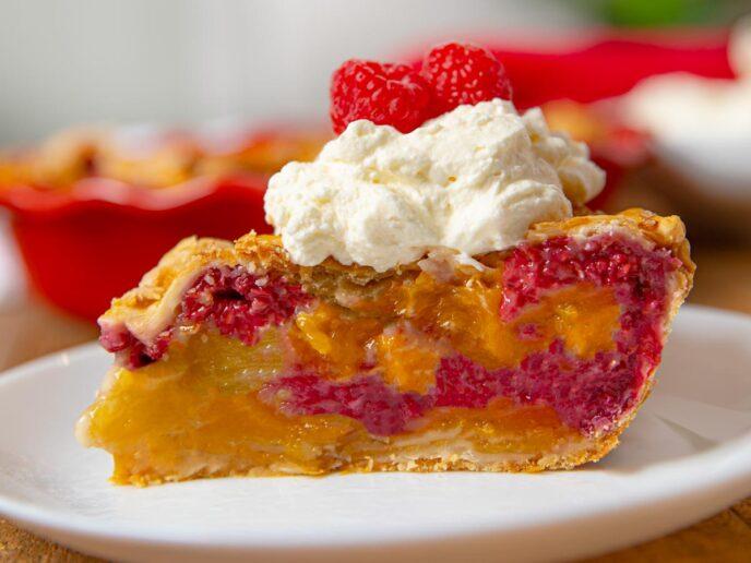 Raspberry Peach Pie slice on plate