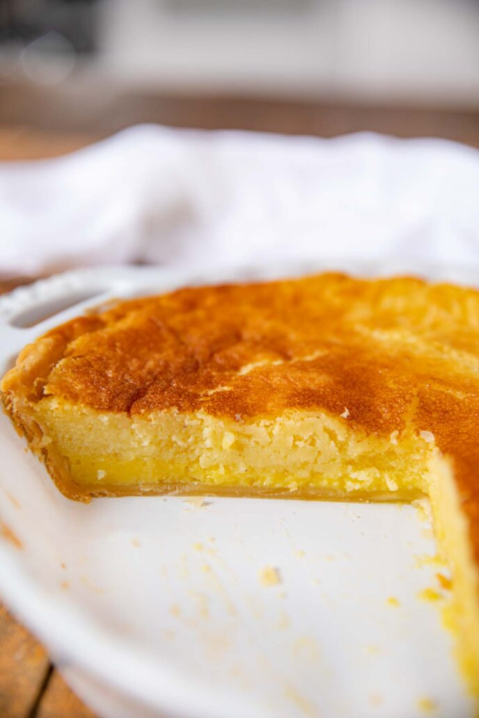 Buttermilk Pie on pie plate with slice removed