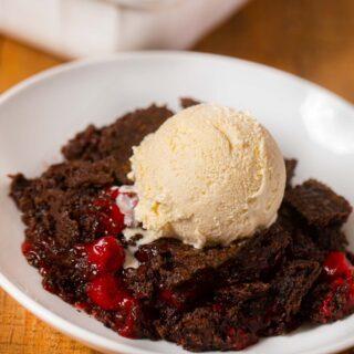 Cherry Chocolate Dump Cake served on plate with vanilla ice cream