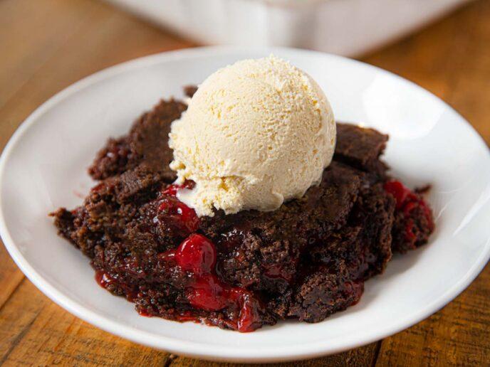 Cherry Chocolate Dump Cake on plate with vanilla ice cream
