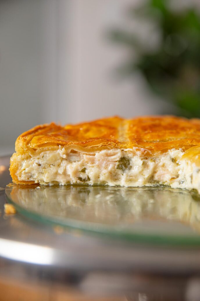 Chicken and Spinach Pie cut in half on cake stand